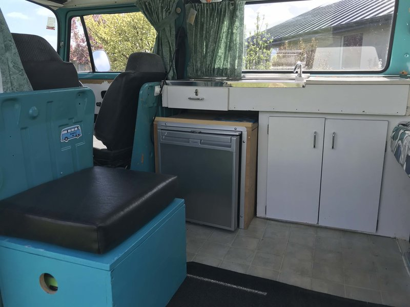 Inside view of fridge and kitchen of Rhonda, teal retro kombi van from NZ Kombi Hire
