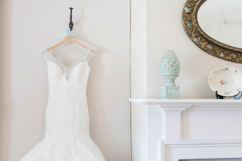 dress hanging by fireplace at springfield manor winery and distillery wedding by costola photography