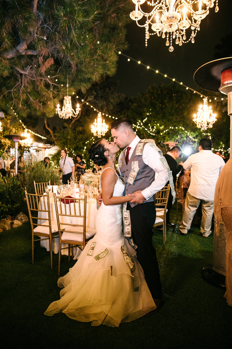 couple kissing at orange county wedding venue seven degrees