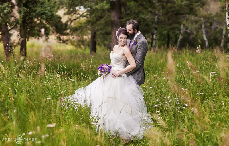 Gorgeous summer wedding portrait in the mountain meadow at Pines at Genesee