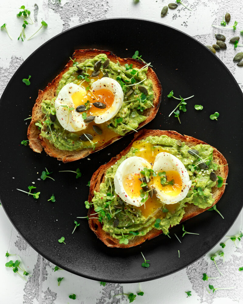 Canva - Healthy avocado and egg toasts with pumpkin and sesame seeds, sprinkled with cress salad