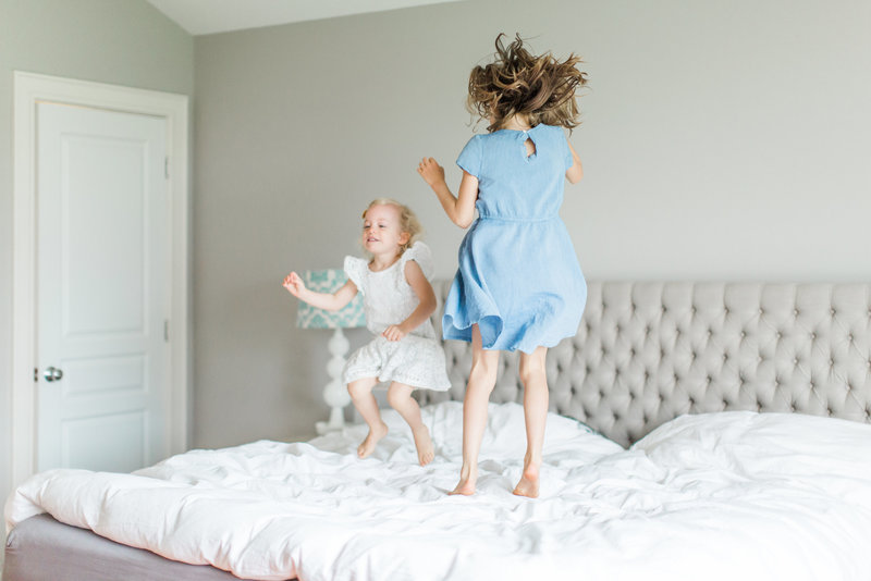 Lifestyle Portraits Children Jumping on Bed Bright and Airy