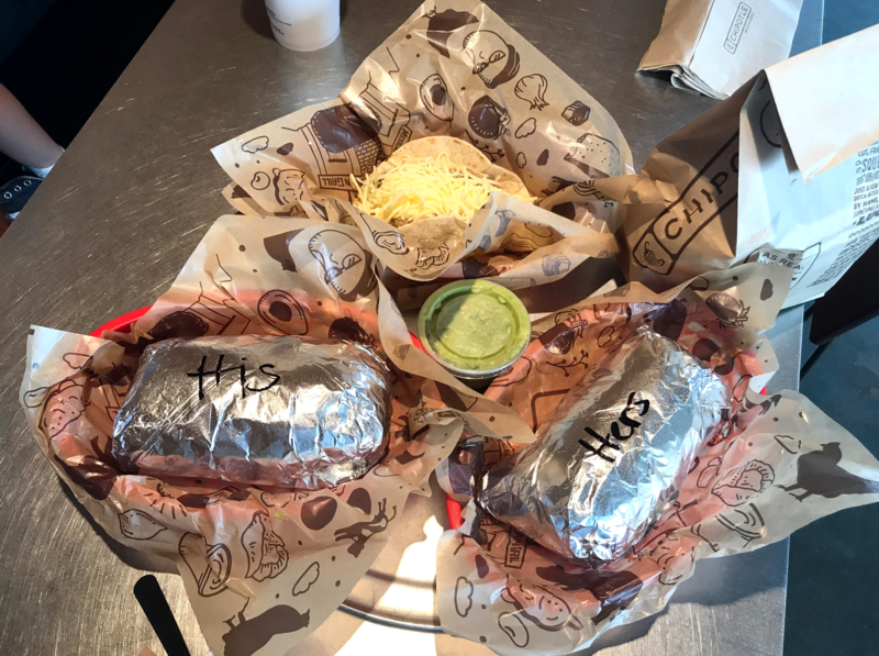 "Chipotle burriots with ""his"" and ""hers"" written on them"