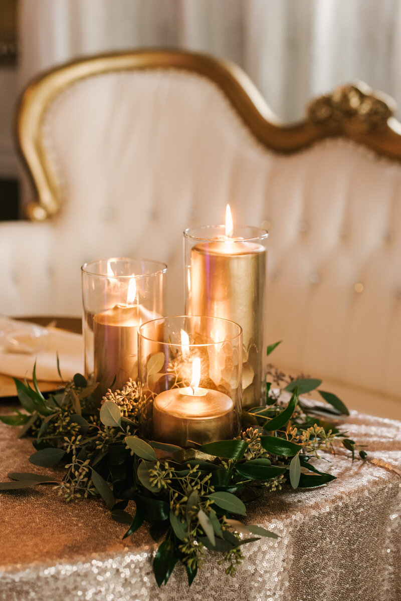 "alt=""gold candles on table"""
