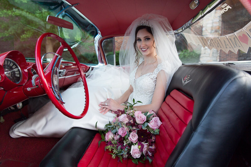 bride in vintage car on wedding day in port huron