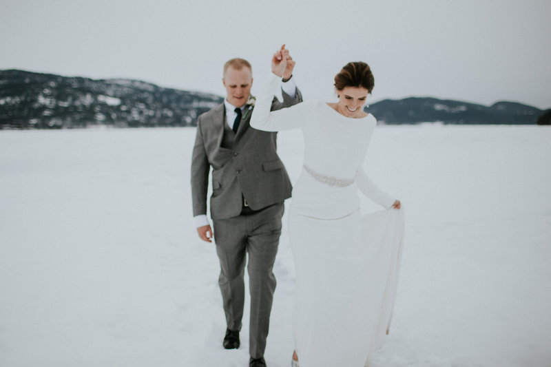 Whitefish MT Lodge Wedding Couple Walking in Snow