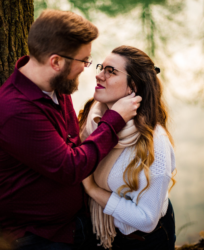 Man strokes cheek of fiancee for engagement photos at Frontier Park