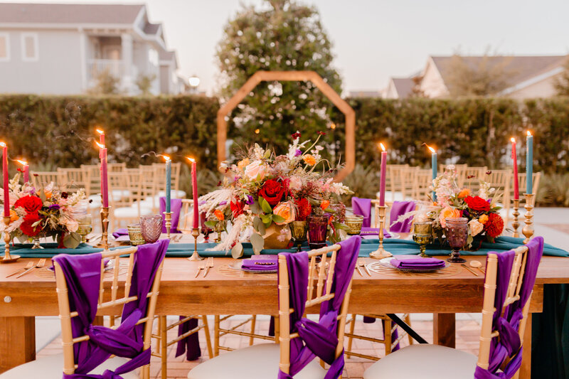"alt=""tapered candles chairs and wedding reception"""