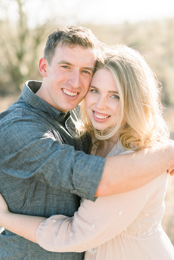 Tucson Desert Engagement Session Photo of Couple Smiling and Hugging | Tucson Wedding Photographer