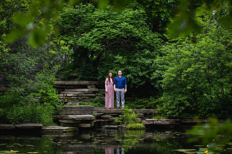 Couple holding hands at the Alfred Caldwell Lily Pool