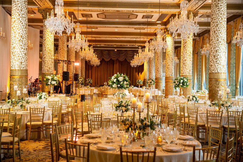 Elegant wedding reception with candles and white roses  in the Gold Coast room at the Drake Hotel.