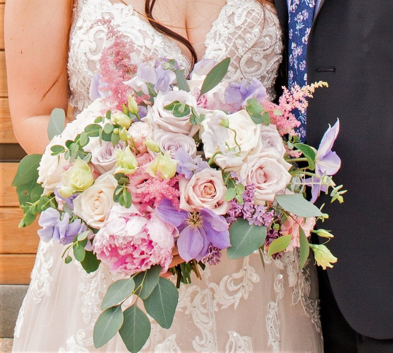 Pastel bridal bouquet with peonies, roses and clematis