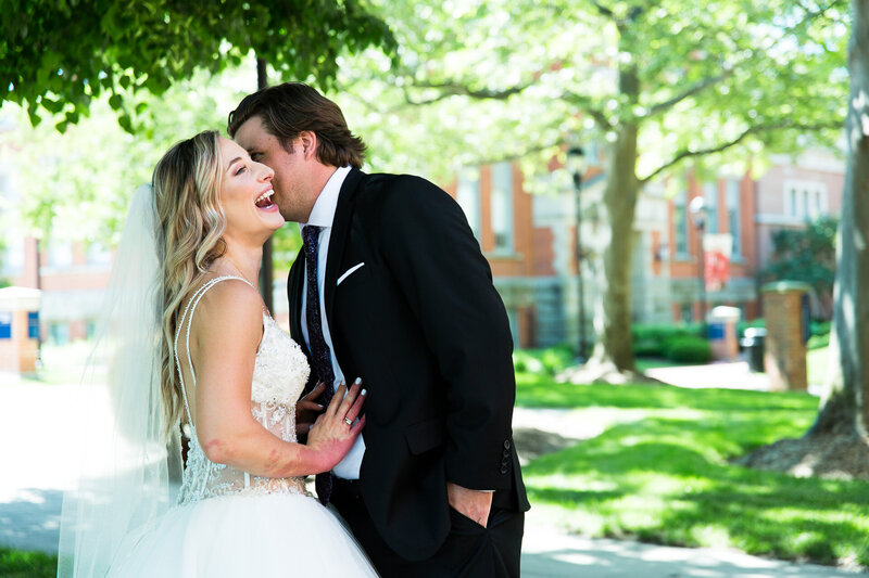 bride and groom laughing at st. Ignatius school cleveland