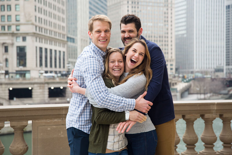 friends celebrating engagement proposal in downtown chicago