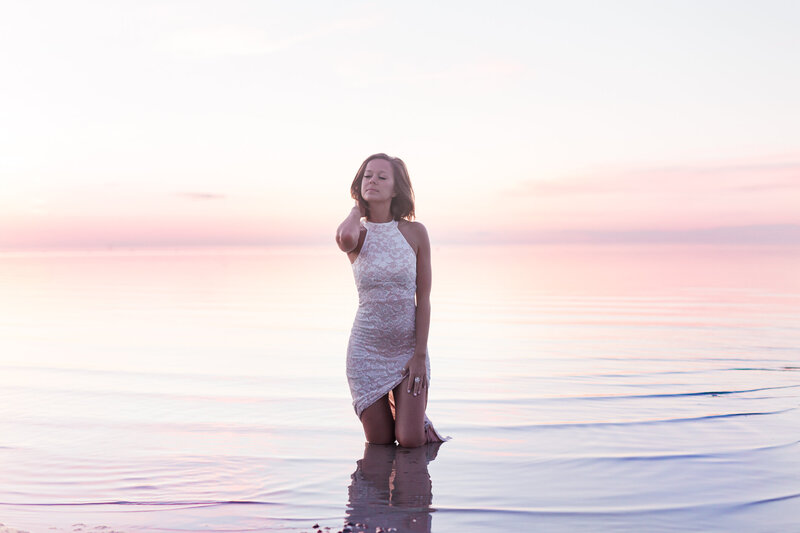 Sunset photo of beautiful girl in lace dress in Okanagan Lake