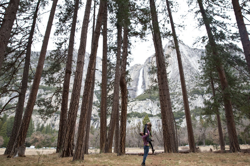 Man lifts dancer girlfriend in Yosemite National Park.