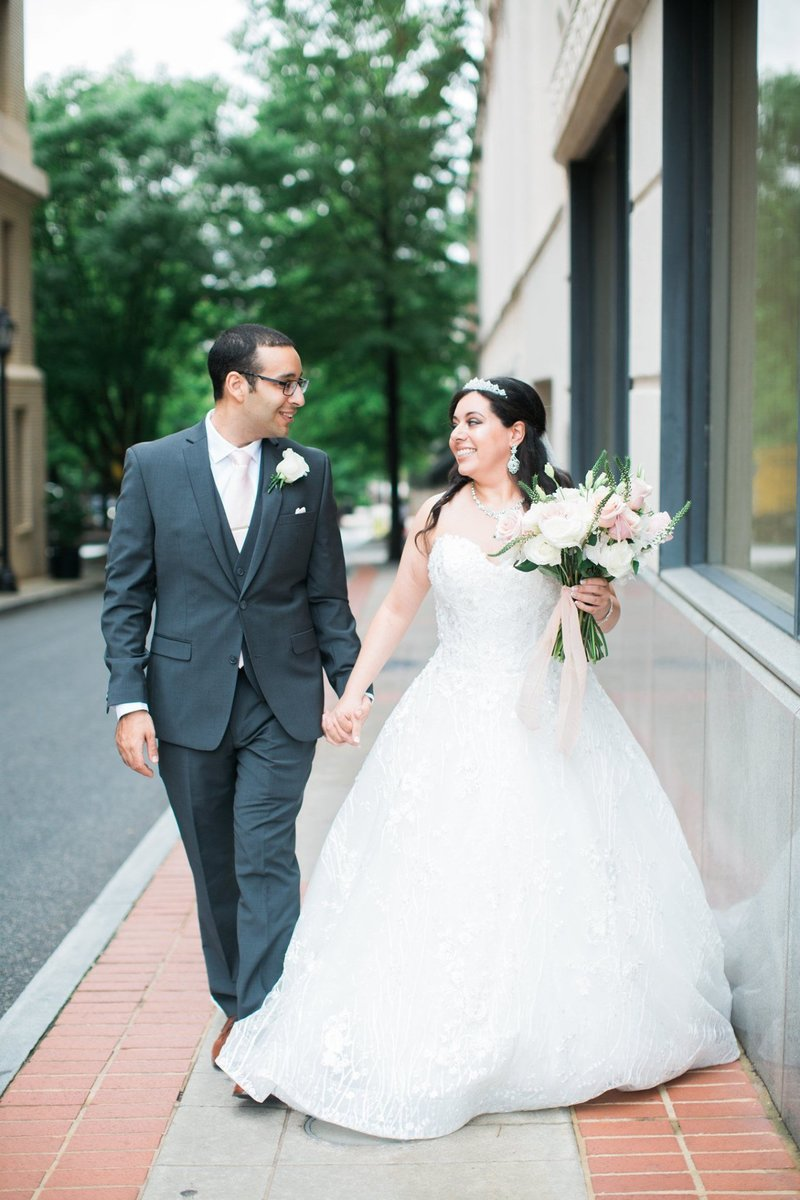 Wedding Photography, bride and groom walking down the street