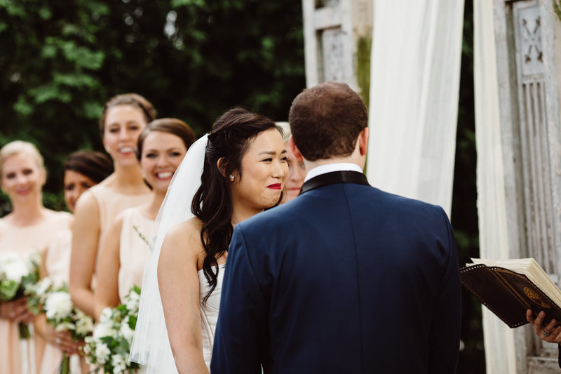 A couple enjoys a moment of laughter during a secular wedding ceremony at Terrain. The couple chose Lehigh Valley Celebrants for their wedding officiant.