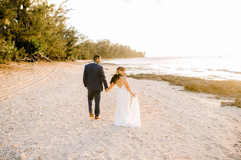 bride and groom at sunset on beach in hawaii