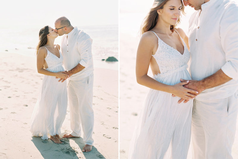 A couple kiss on the beach during their maternity session