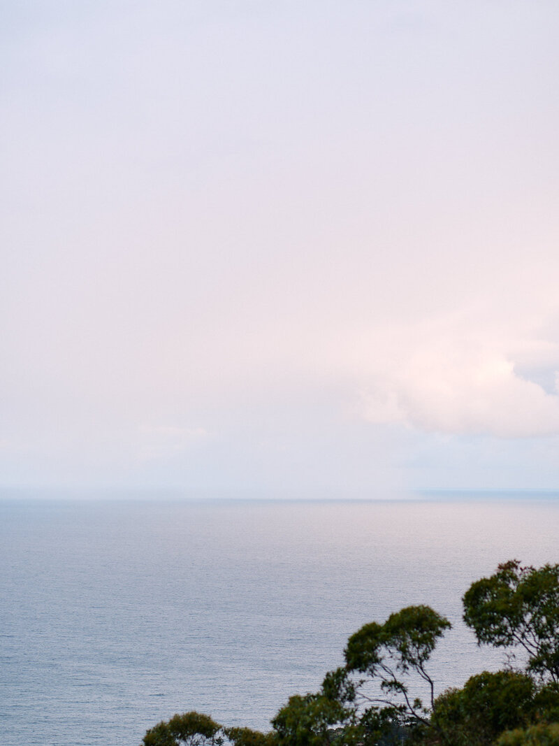 View of rain out to sea from verandah at Tumbling Waters Retreat