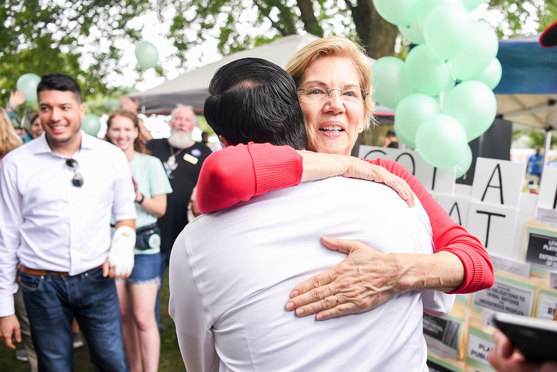 Julian Castro 2020 democratic primary hugging Elizabeth Warren