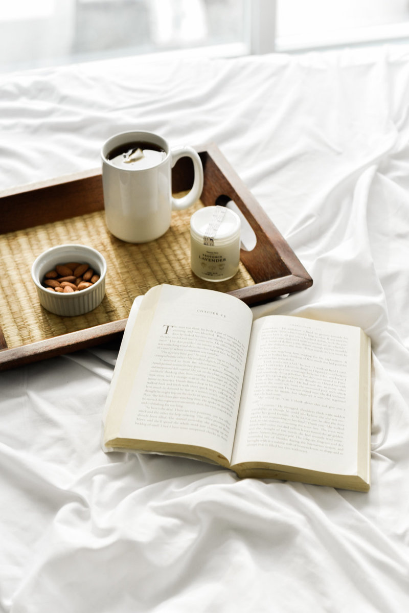 Book, white sheets, mug