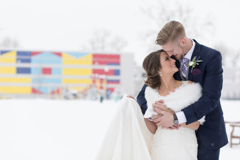 Husband and wife embracing in the snow