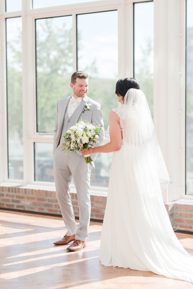 groom sees bride for first time during first look  at Stone House at Stirling Ridge Maryland Wedding by  Costola Photography