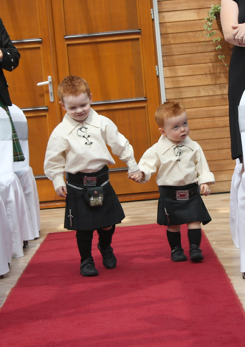 Page boys coming down the aisle
