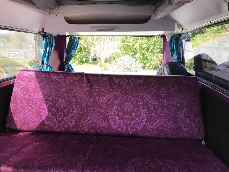 Inside view of seating of Pippi, purple retro kombi van from NZ Kombi Hire