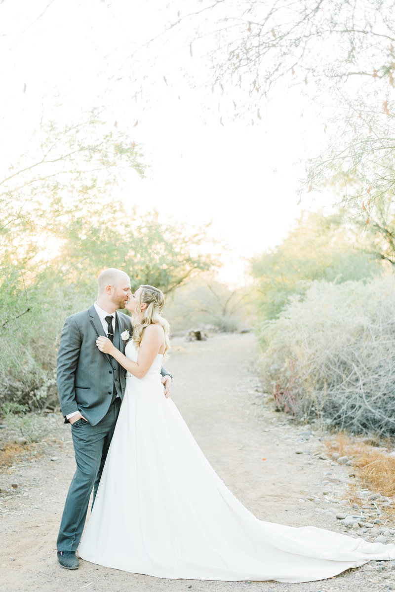 Bride and groom kissing in Arizona