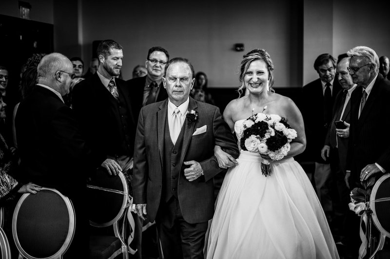 Bride and her father walking down the aisle at Sheraton Erie Bayfront Hotel wedding