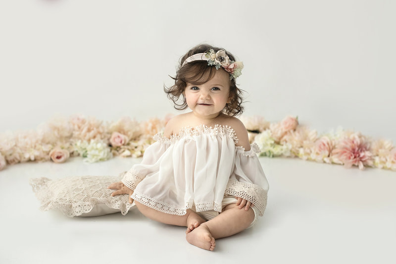 columbus ohio photographer baby girl first birthday boho simple all white floral