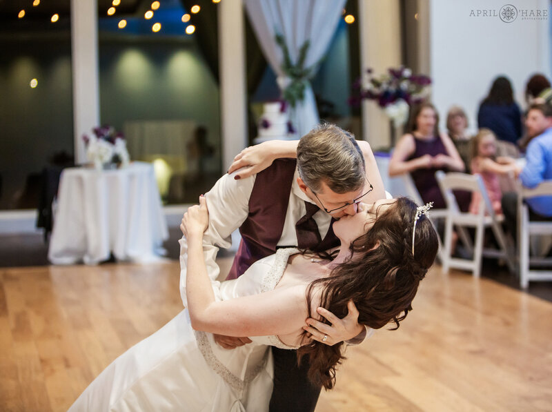 Groom dips his bride at Ashley Ridge Wedding Reception in Littleton