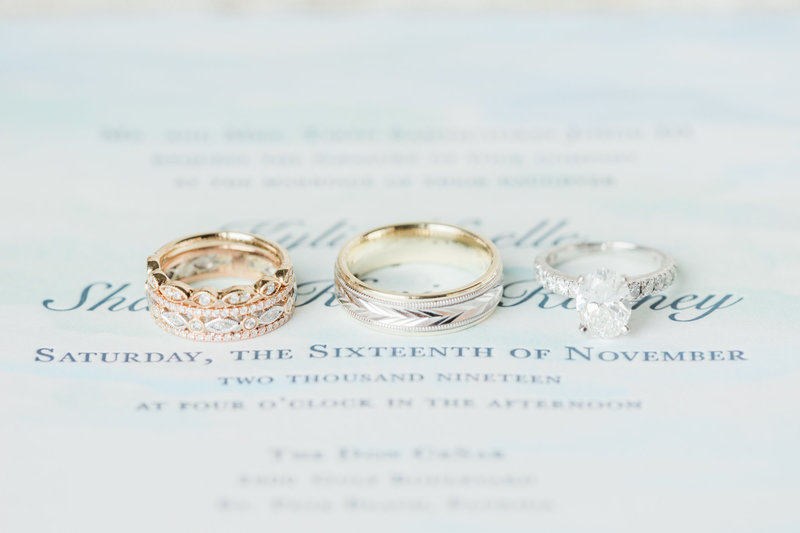 wedding rings on invitation suite at Don Cesar Wedding Photographer in St. Petersburgh Florida by Costola Photography
