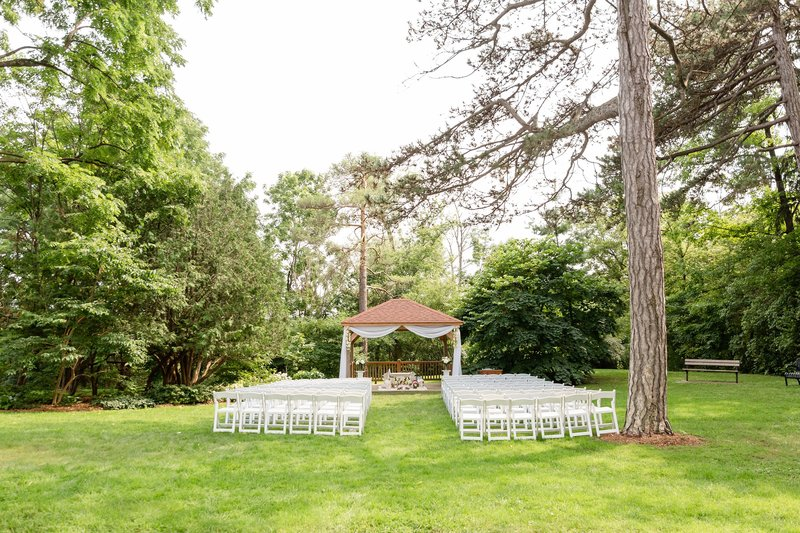 One of the many outdoor ceremony location set ups on the grounds of Elsie Perrin Williams Estate
