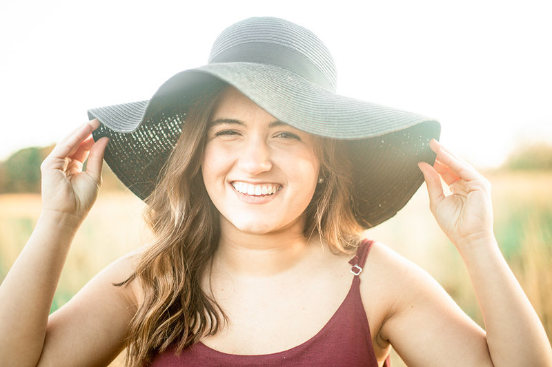 A senior poses with a floppy hat in Gastonia, North Carolina.