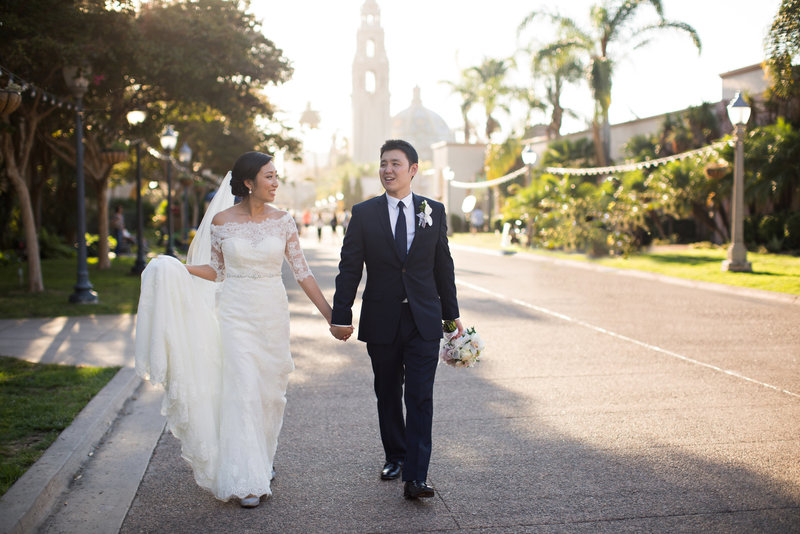 Bride and Groom walking through Historic Balboa Park