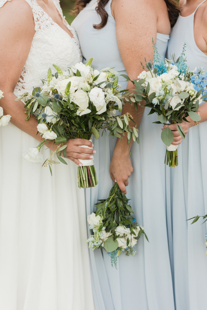 classic white bridesmaids bouquets with light blue dresses  at Stone House at Stirling Ridge Maryland Wedding by  Costola Photography