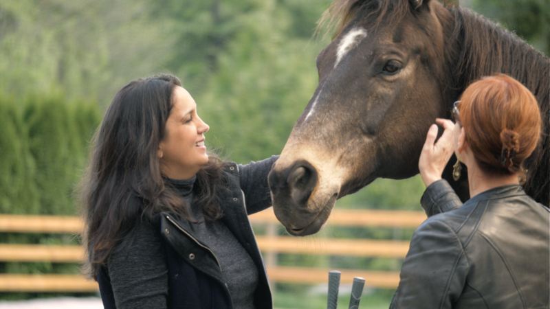 Nafissa coaching with her horse and Believe and See Ranch in Vancouver