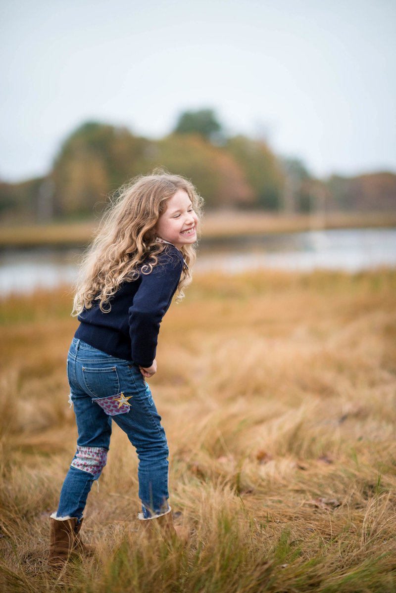 girl smiling at her brother during family photography session