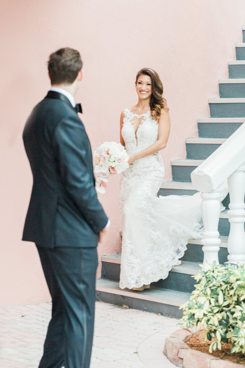 bride walking down staircase in wedding dress at Don Cesar wedding in St Petersburg Florida by Costola photography