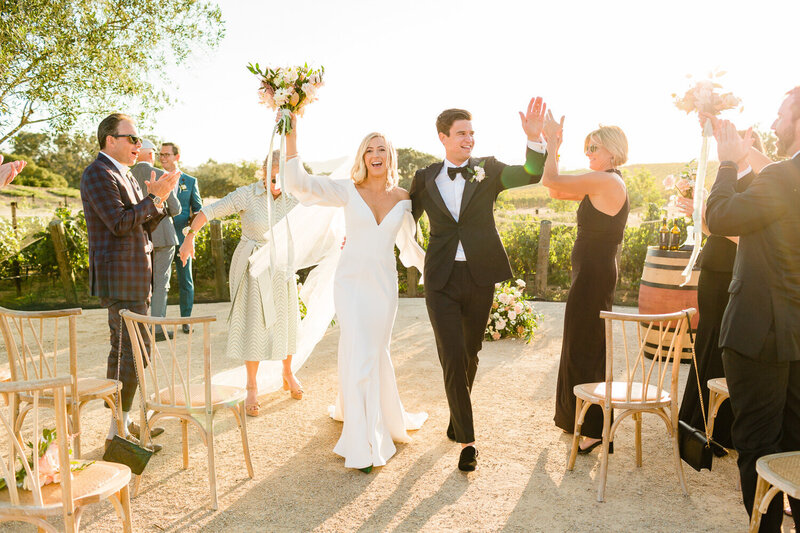 Groom and bride celebrating at their wedding in Santa Barbara, California. Photo taken by Cheers Babe Photo.