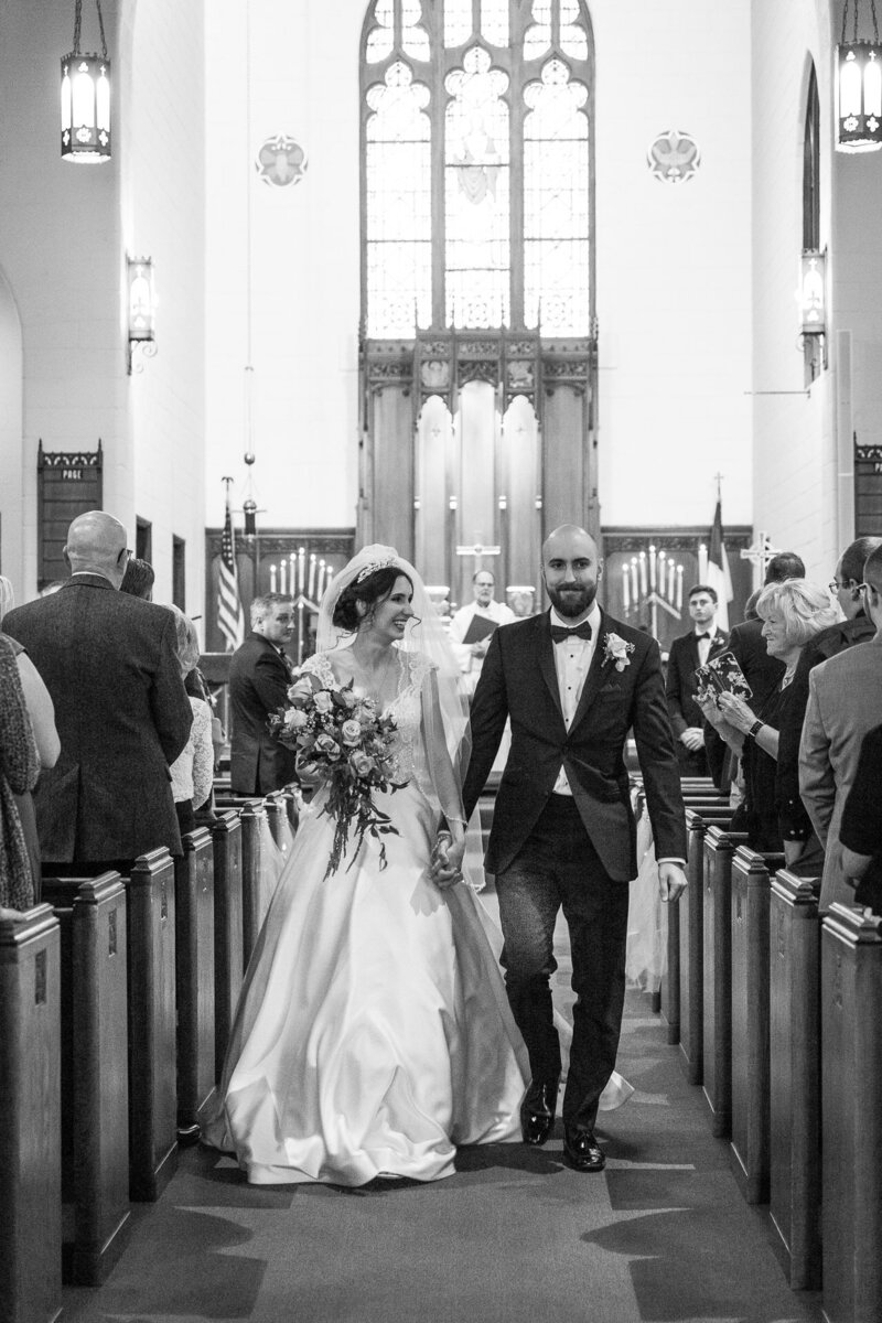 bride and groom walk down aisle at trinity lutheran church in port huron