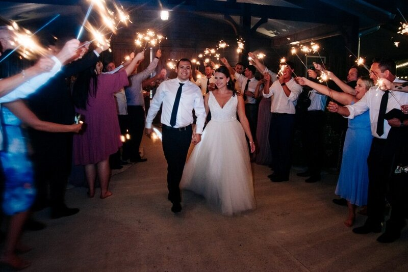 Sparkler exit send off at Peach Creek Ranch for bride and groom