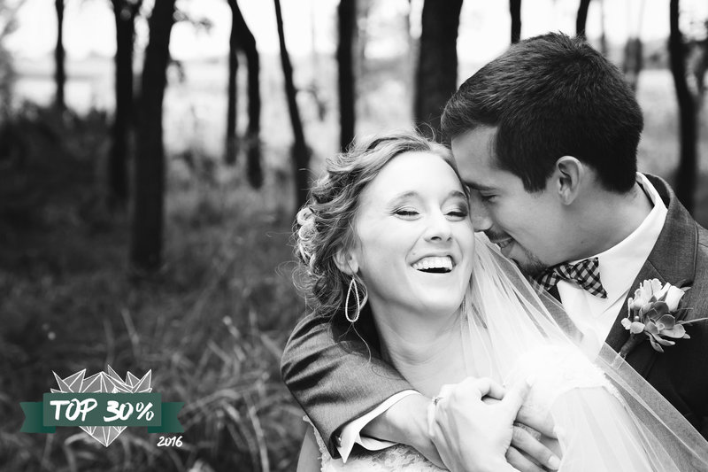 Bride and Groom laughing in the woods