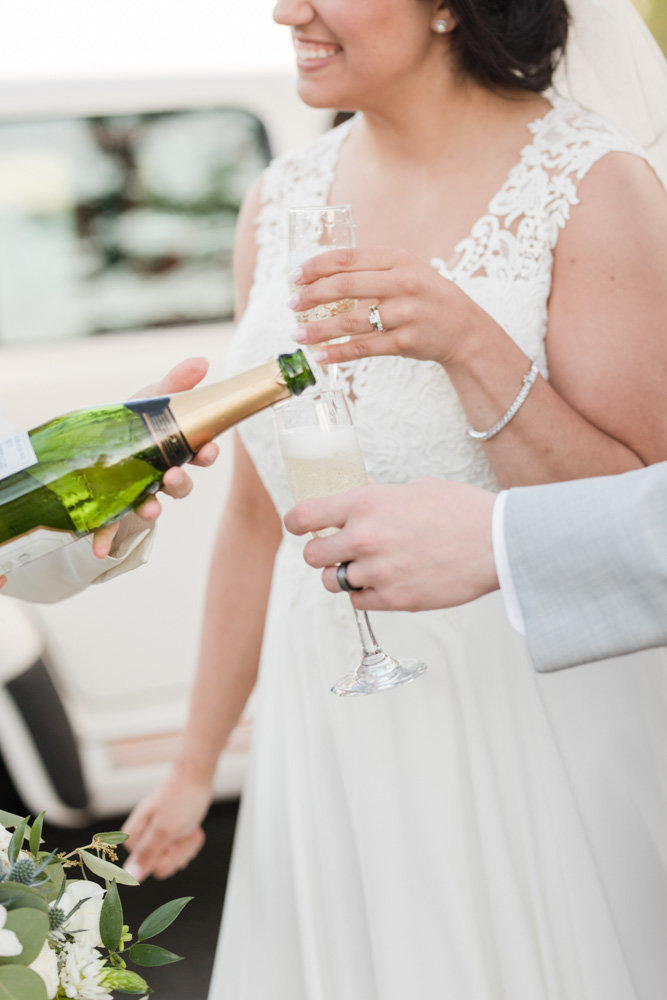 car service pouring champagne  at Stone House at Stirling Ridge Maryland Wedding by  Costola Photography