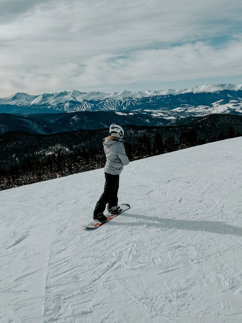 Christina snowboarding in Colorado.
