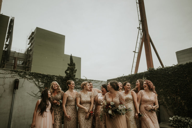 bridesmaids in gold mettalic dresses at this New Years Eve wedding